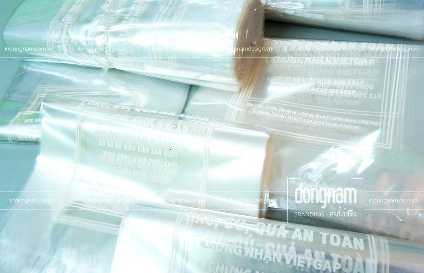 in túi bóng kính cửa hàng rau sạch